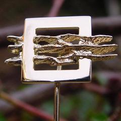 sl7 logo sieraden relatiegeschenk bedrijven logospeld goud edelsmid handgemaakt www.tonvandenhout.nl goudsmid origineel bijzonder jubilaris jubileum embleem herinnering