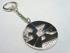 sl4282-logo-logo's-sieraden-zilver-letters-naam-sleutelhanger-edelsmid-www.tonvandenhout.nl-goudsmid-huwelijk-relatiegeschenk-bedrijfslogo-jubileum-bedrijven-handgemaakt