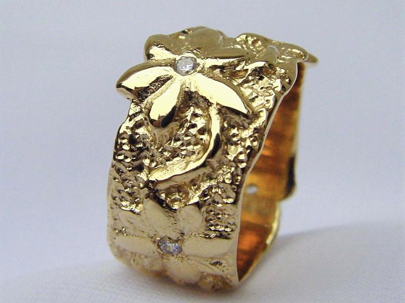 ssp44-ring-logo-logo's-sieraden-goud-briljant-origineel-bloem-bloemen-edelsmid-www.tonvandenhout.nl-goudsmid-relatiegeschenk-jubileum-handgemaakt-bijzonder-uniek-juwelier-specials